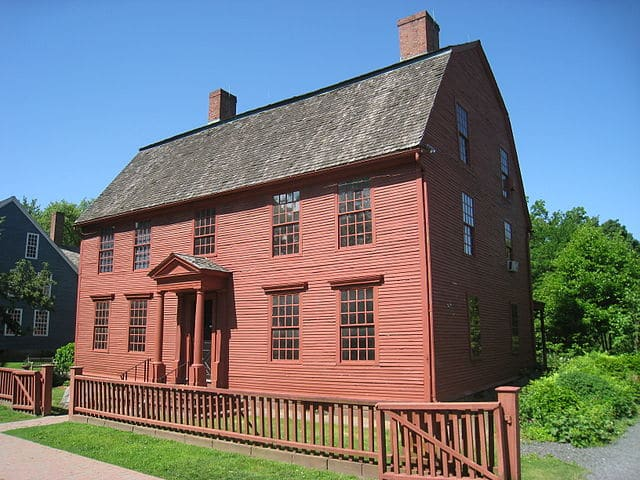 A red plank two-story building.