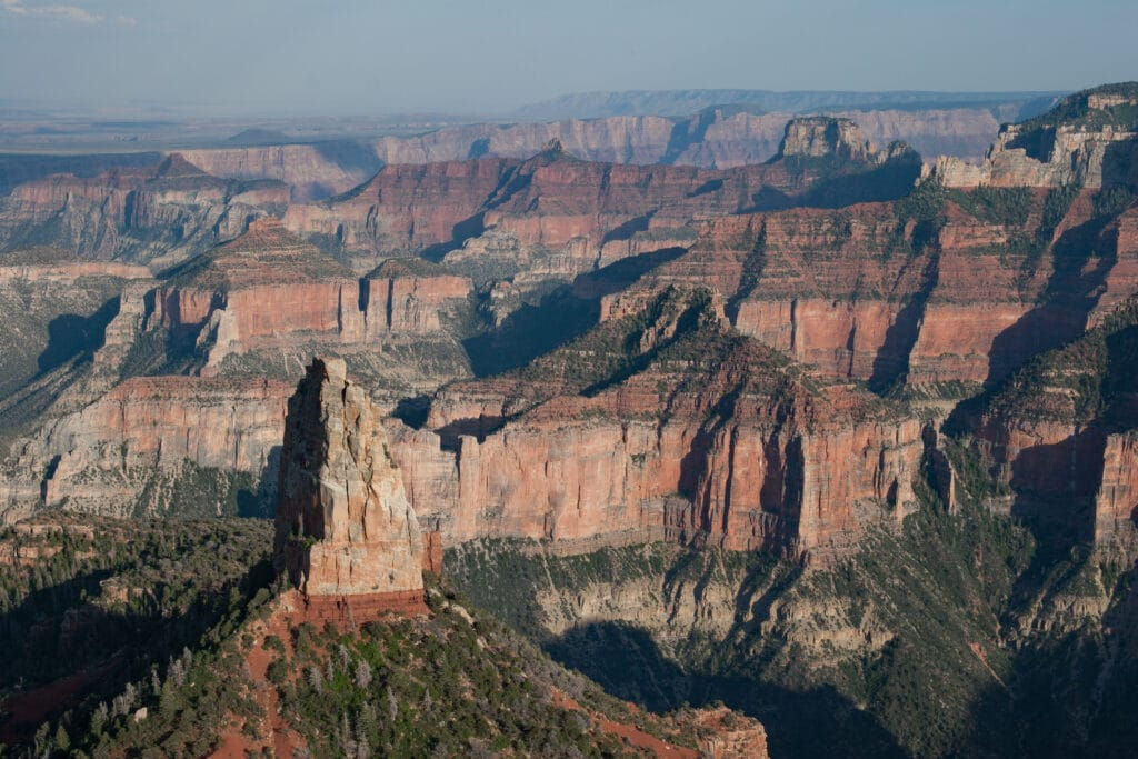 View of Grand Canyon from Point Imperial on North Rim of Grand Canyon National Park on summer afternoon.