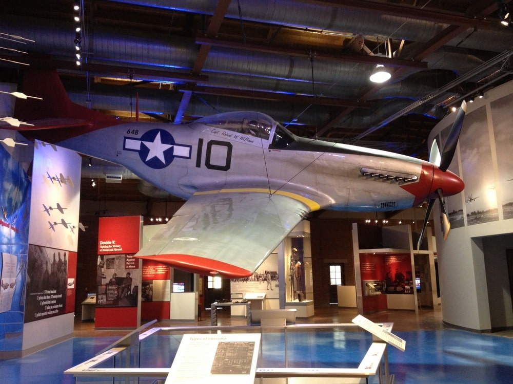 A Tuskegee airplane hanging in a musuem