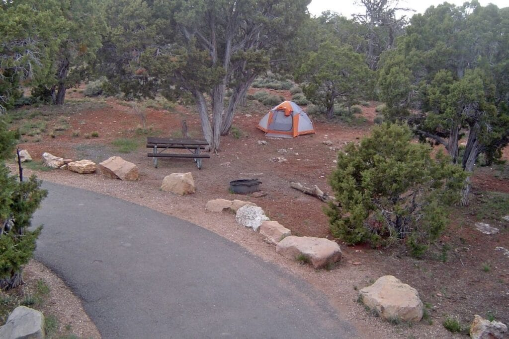 An elevated view of a orange and grey tent in Desert View Campground