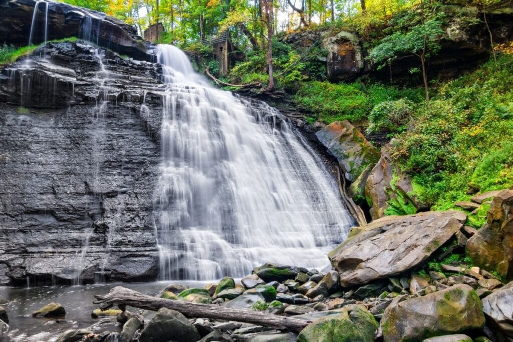 A waterfall cascading over a rock face.