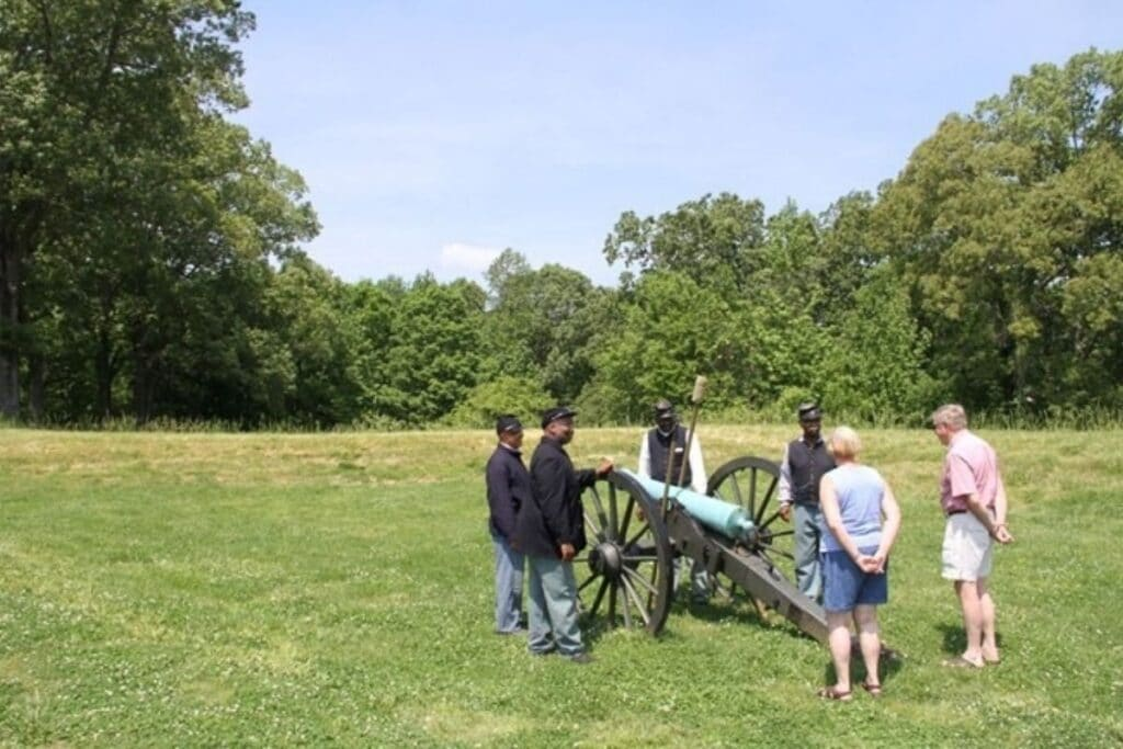Some visitors listen to a reenactment of the battle