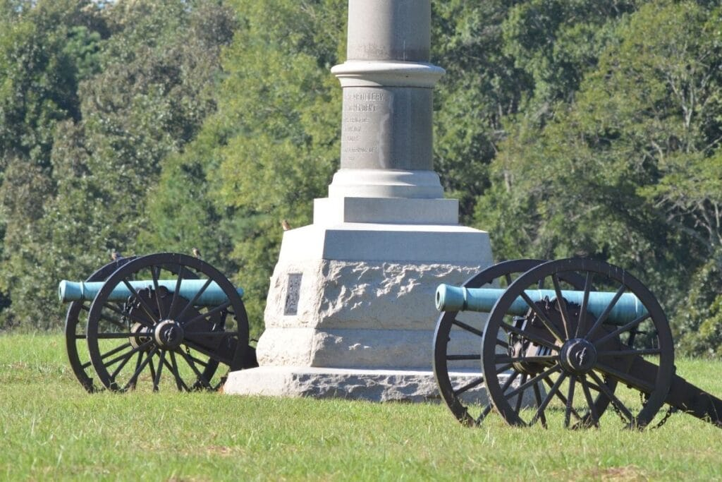 Two civil war canons at the base of a monument