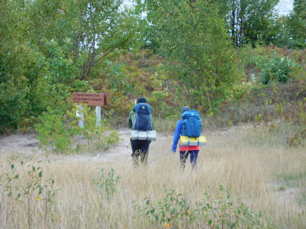 Two hikers heading down the North Country Trail.